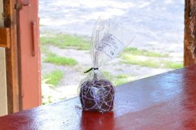 A Fresh Picked Gala Apple Covered in Caramel, Dipped in Dark Chocolate, and Sprinkled with Sea Salt